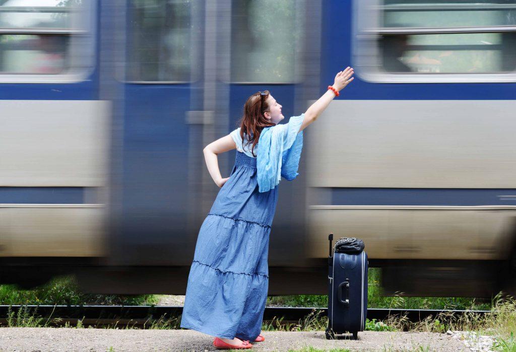 Young woman waving at train